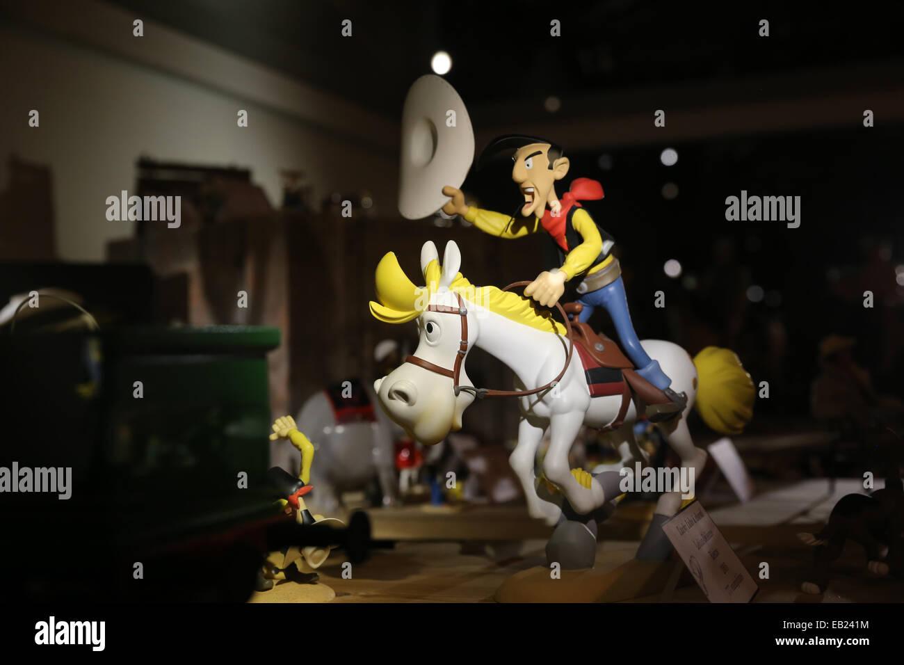 mini cowboy riding white horse figure - Stock Image