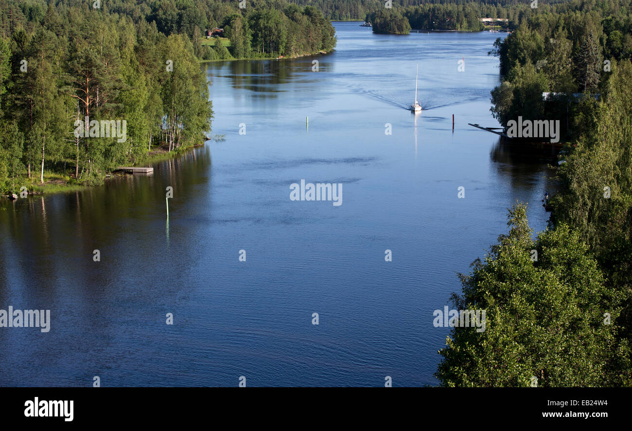 Sailboat driving with motor at inland , Leppävirta river , Finland - Stock Image