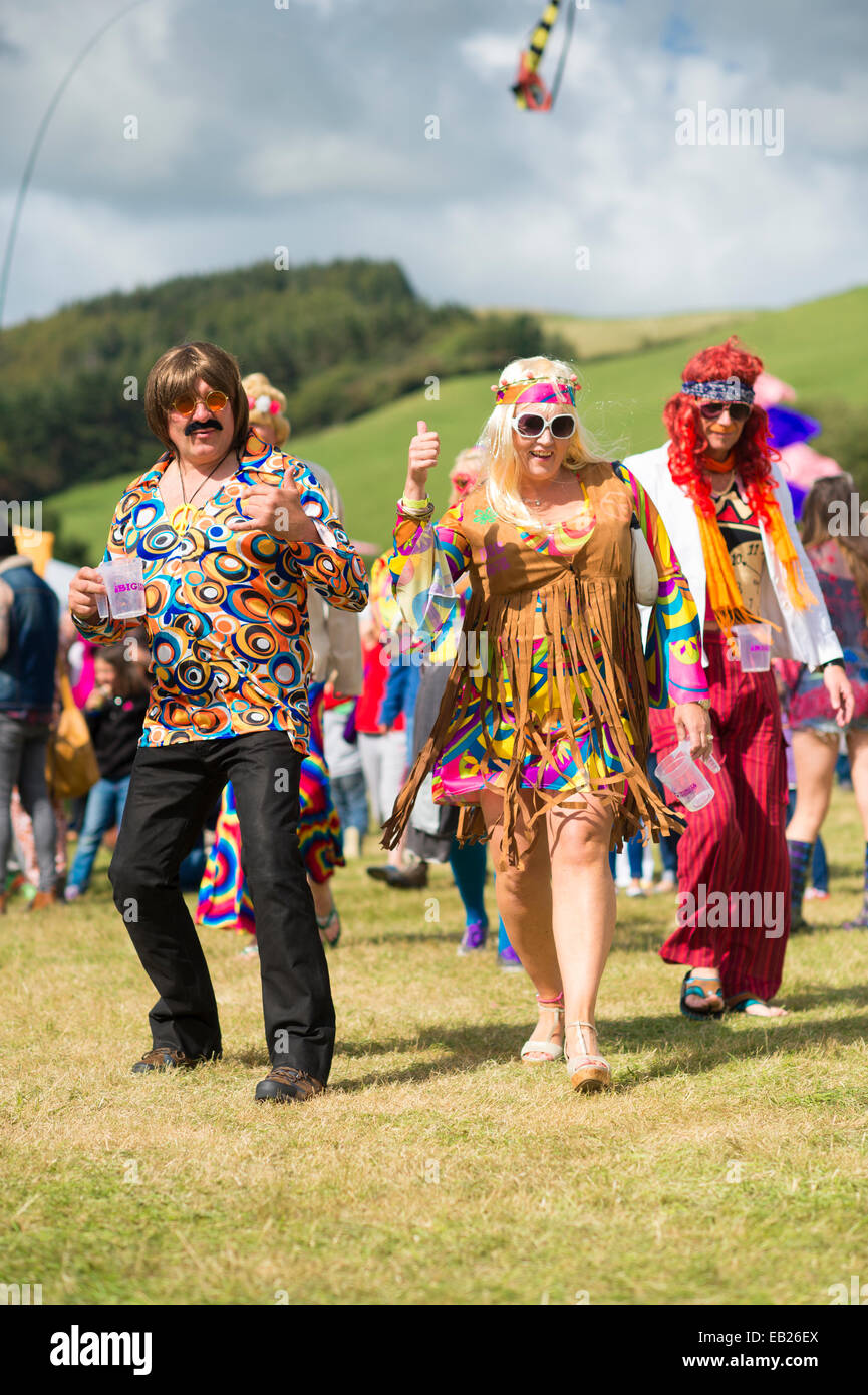 Audience members in 70's fancy dress clothes at the Big Tribute music festival Aberystwyth UK August bank holiday - Stock Image