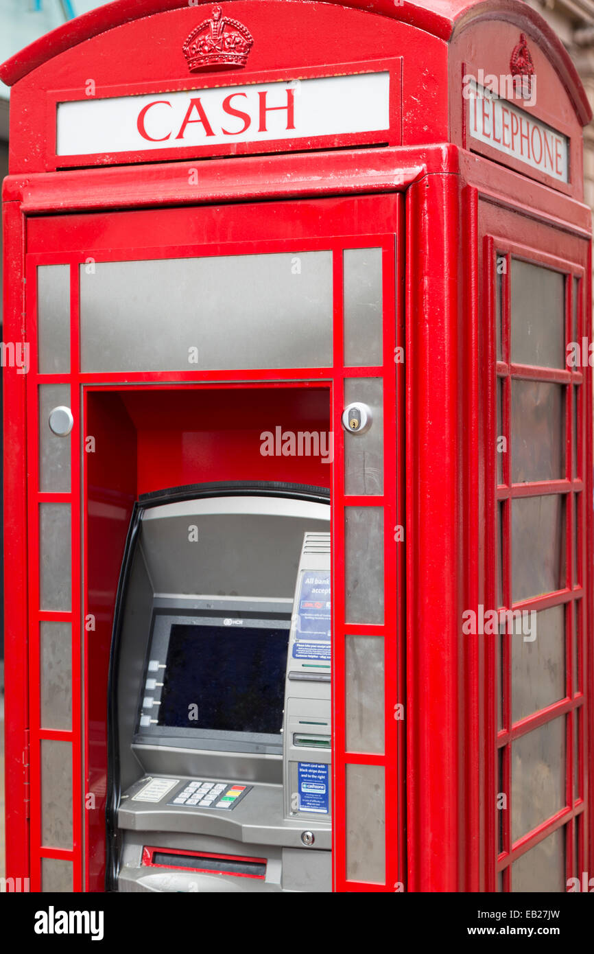 UK, Lincoln, old telephone box, now being used as a cash machine. - Stock Image