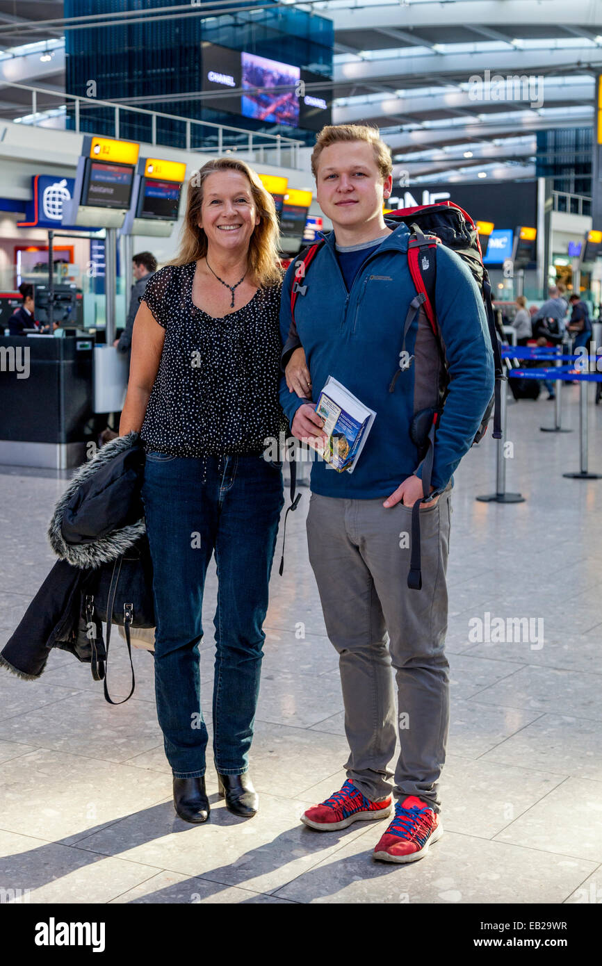 Backpacker Off Travelling Saying Goodbye To Family, Heathrow Airport, London, England - Stock Image