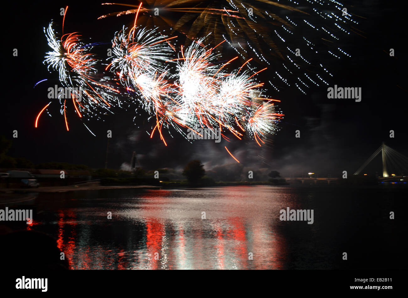 A firework display by the Marine Lake in Southport during the first day of the three day British Musical Fireworks - Stock Image