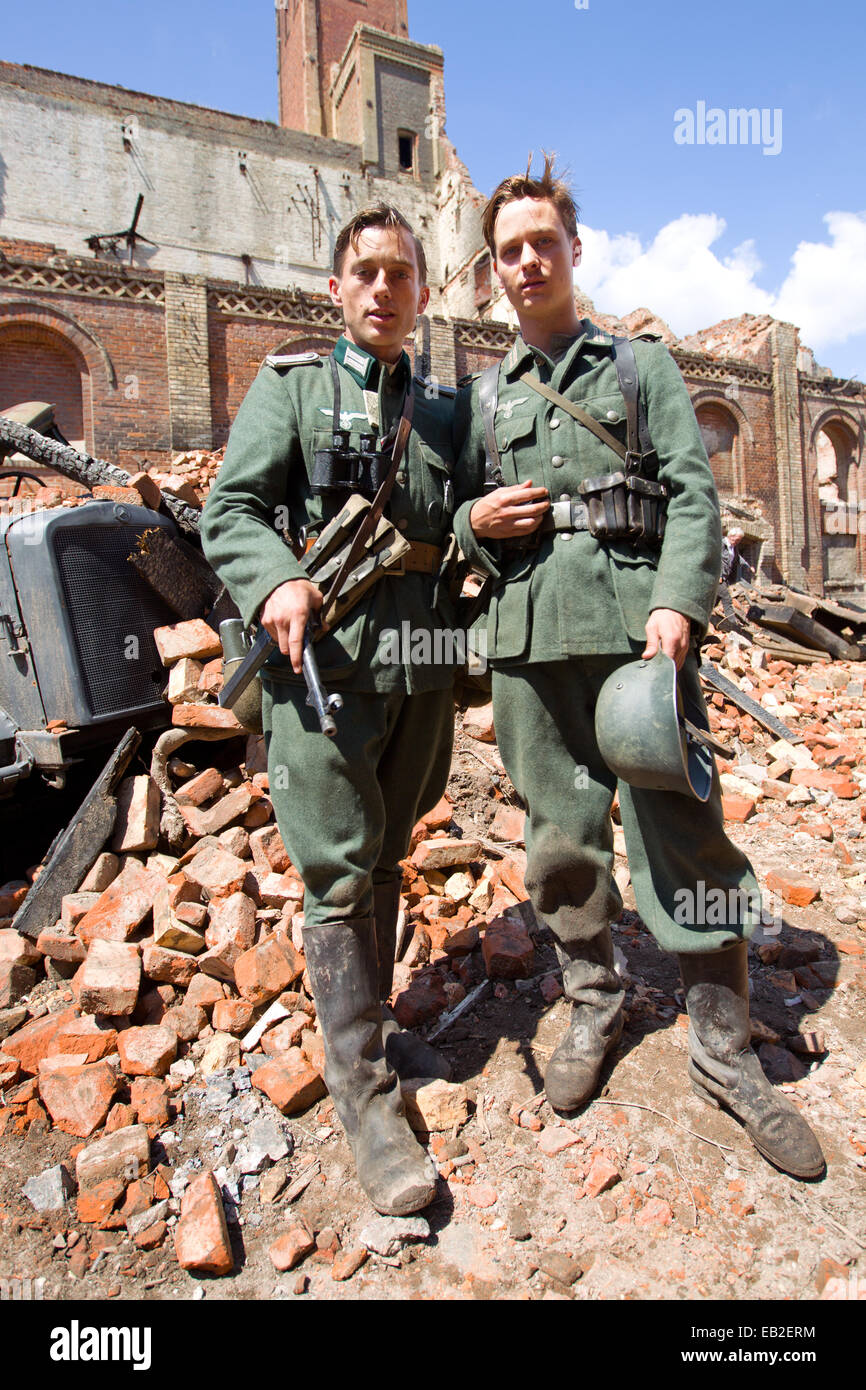Actors Tom Schilling (R) and Volker Bruch as pose during the filming of the German TV production of 'Unsere - Stock Image