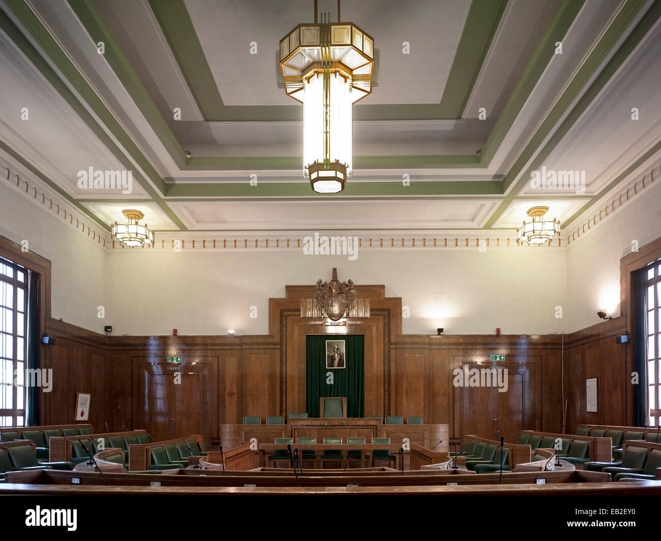 Hackney Town Hall, London, United Kingdom. Architect: Hawkins Brown Architects LLP, 2012. Council Chamber Room with original oak Stock Photo