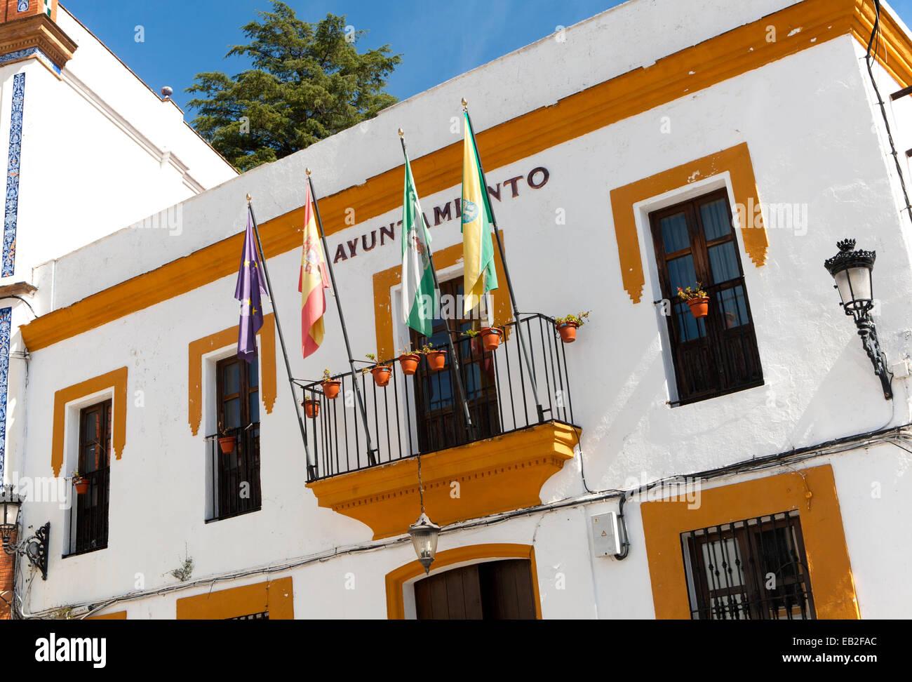 Ayuntamiento town hall building with flags in village of Alajar, Sierra de Aracena, Huelva province, Spain Stock Photo