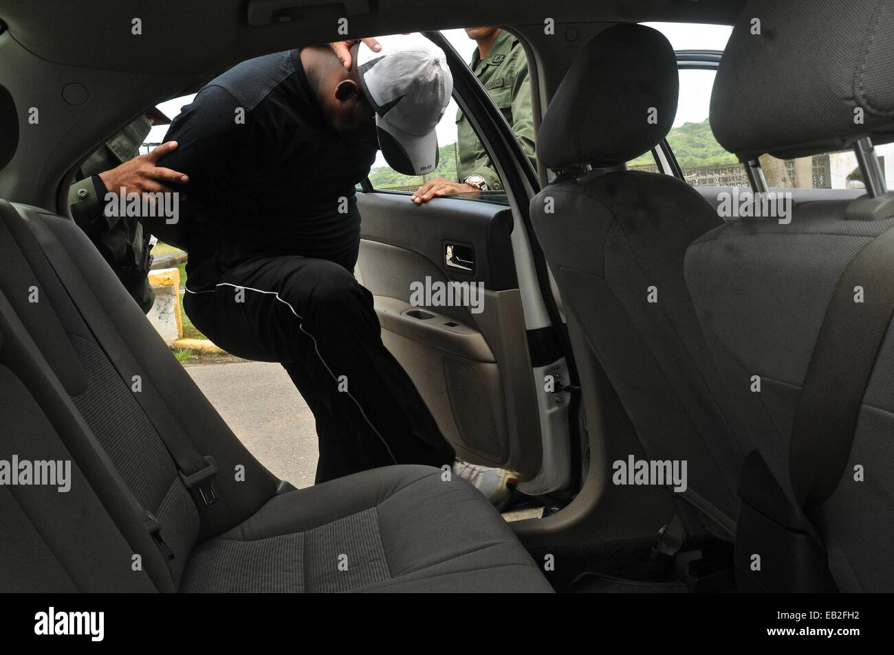 A practice arrest at a tactical and firearms training course at the Panamanian National Police Force Academy. - Stock Image