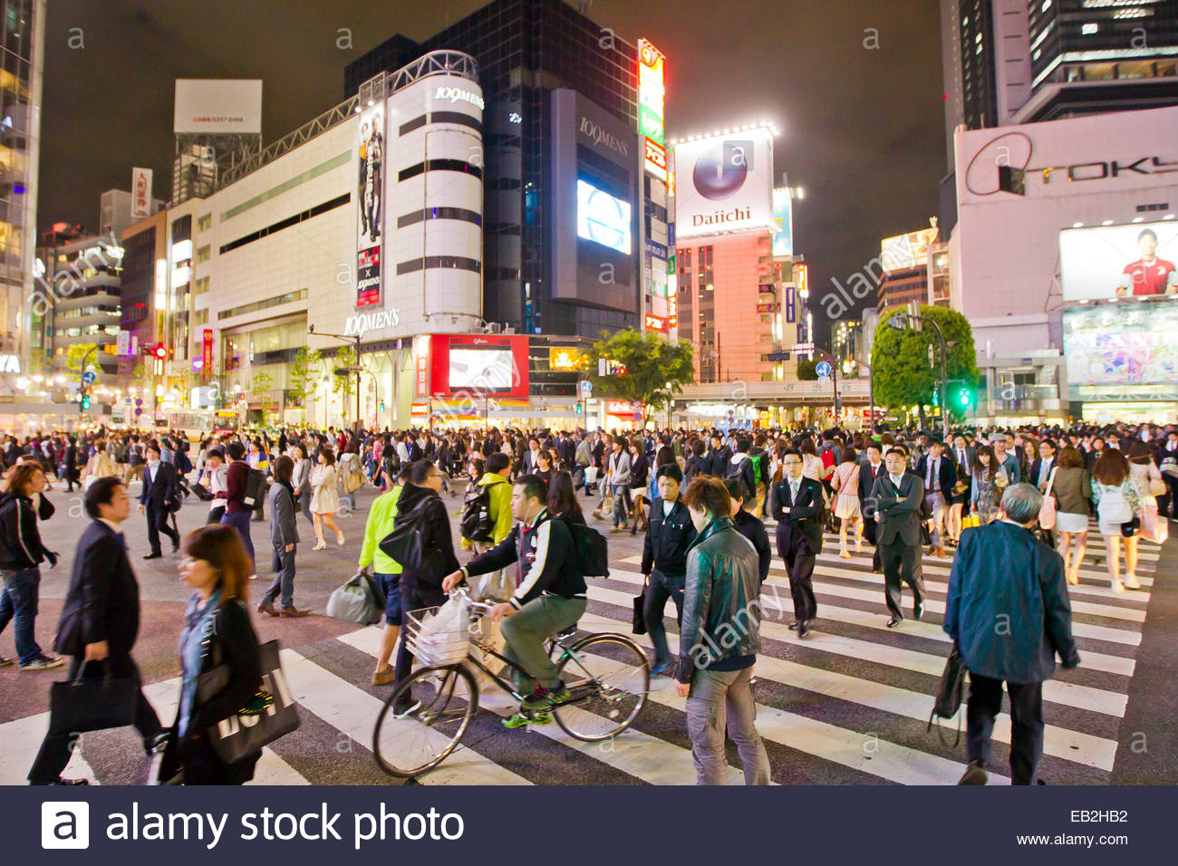 The famous Shibuya crossing where thousands of people cross each day. - Stock Image