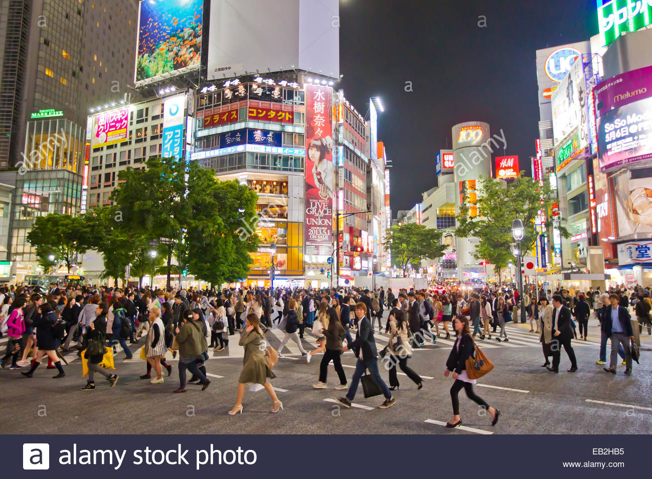 The famous Shibuya crossing where thousands of people cross daily. - Stock Image