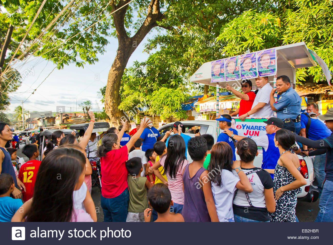 A political parade brings out super celebrity, actor and Senator, Ramon 'Bong' Revilla, Jr., in Manila. - Stock Image