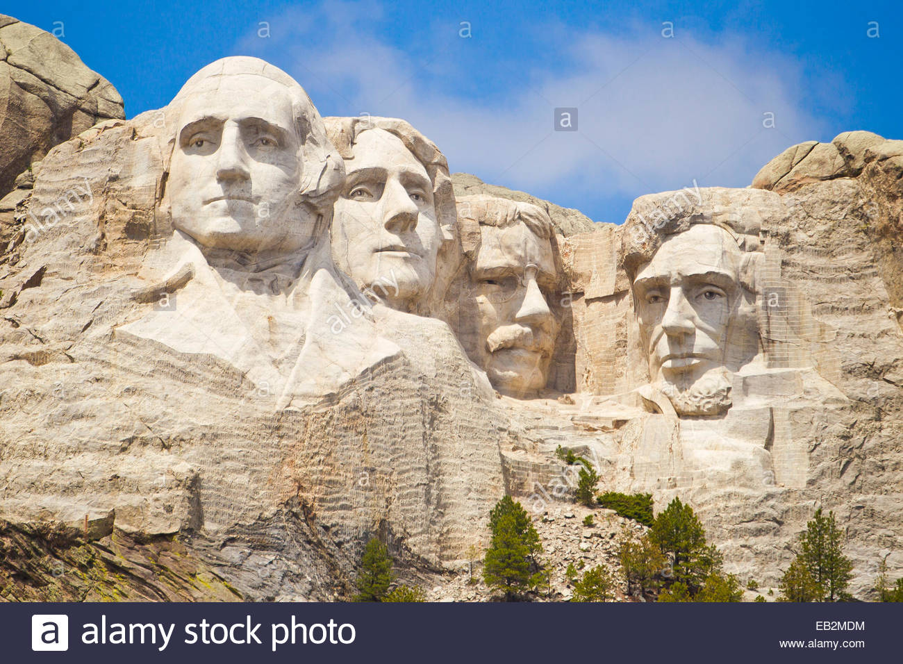 Low angle view of the sculpted images of American presidents Washington, Jefferson, Theodore Roosevelt, and Lincoln, - Stock Image