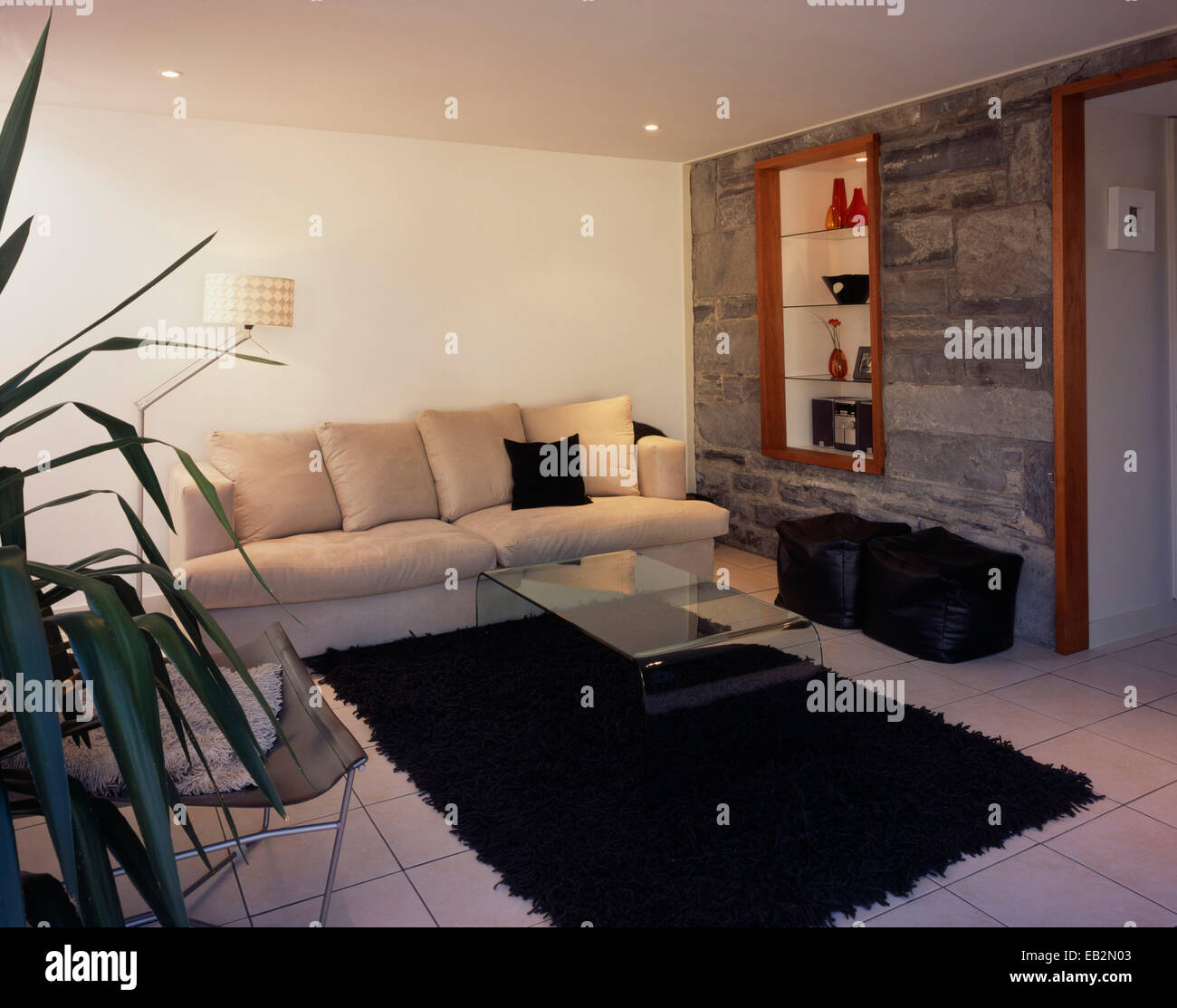 Coffee table on rug in front of sofa in living room in The Grainstore, Perthshire, Scotland Stock Photo