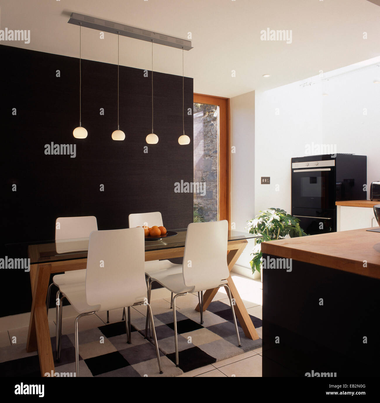 Modern kitchen with dining table and chairs in The Grainstore, Perthshire, Scotland - Stock Image