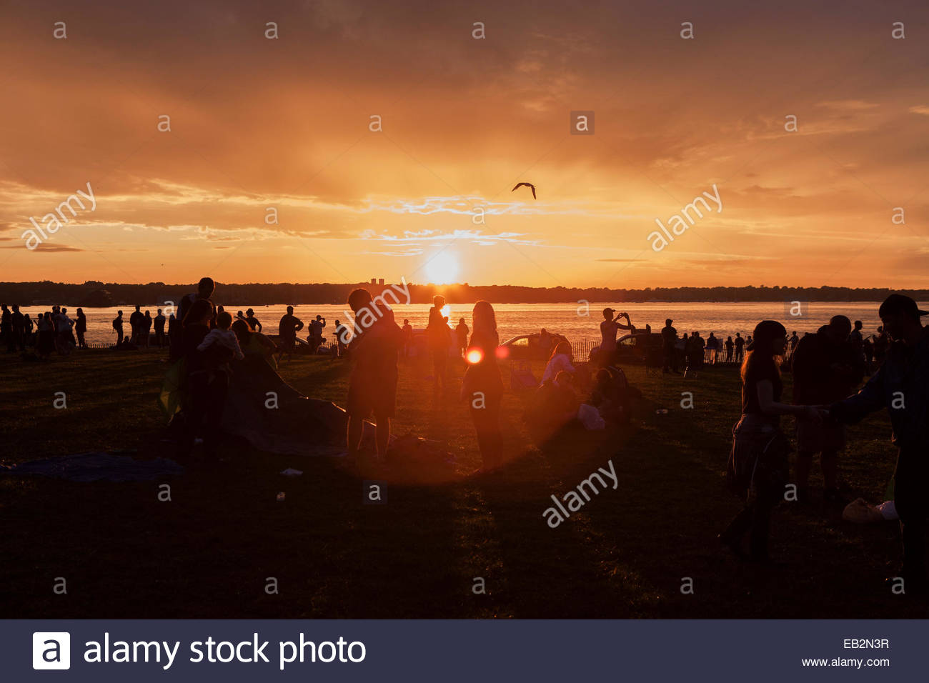 Fans packing up at sunset at Newport Harbor as folk festival closes - Stock Image