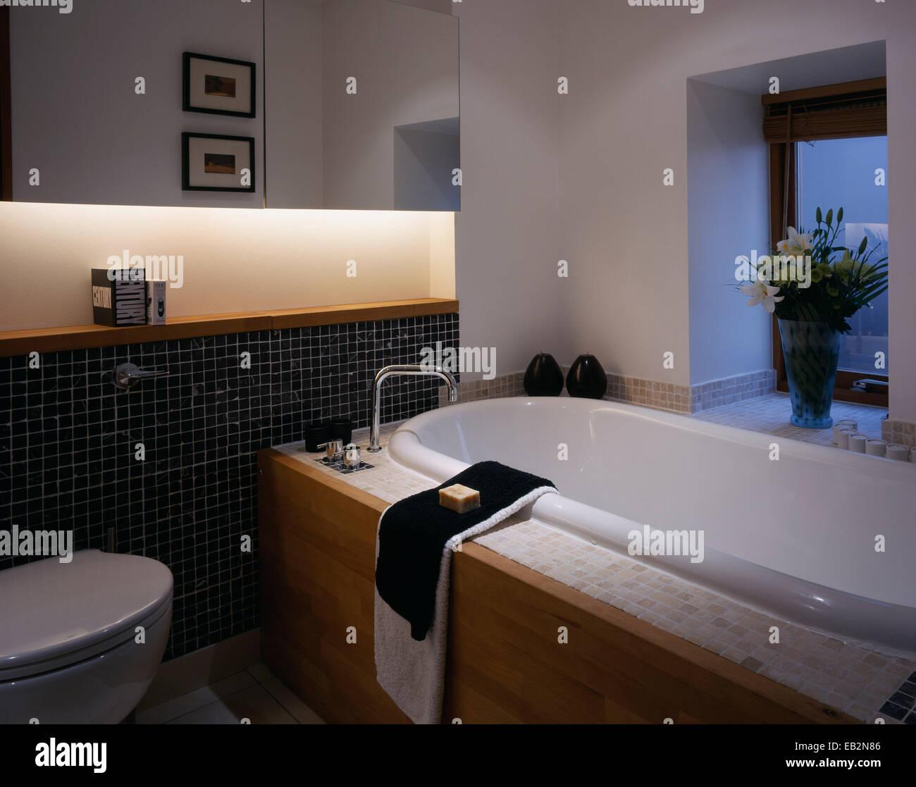 Bathtub in modern bathroom in The Grainstore, Perthshire, Scotland - Stock Image