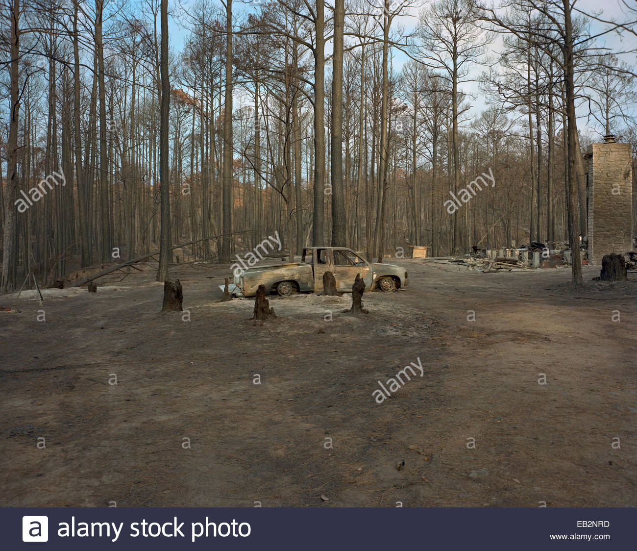 A burned out truck at a homesite that was completely destroyed in Bastrop, Texas fires. - Stock Image