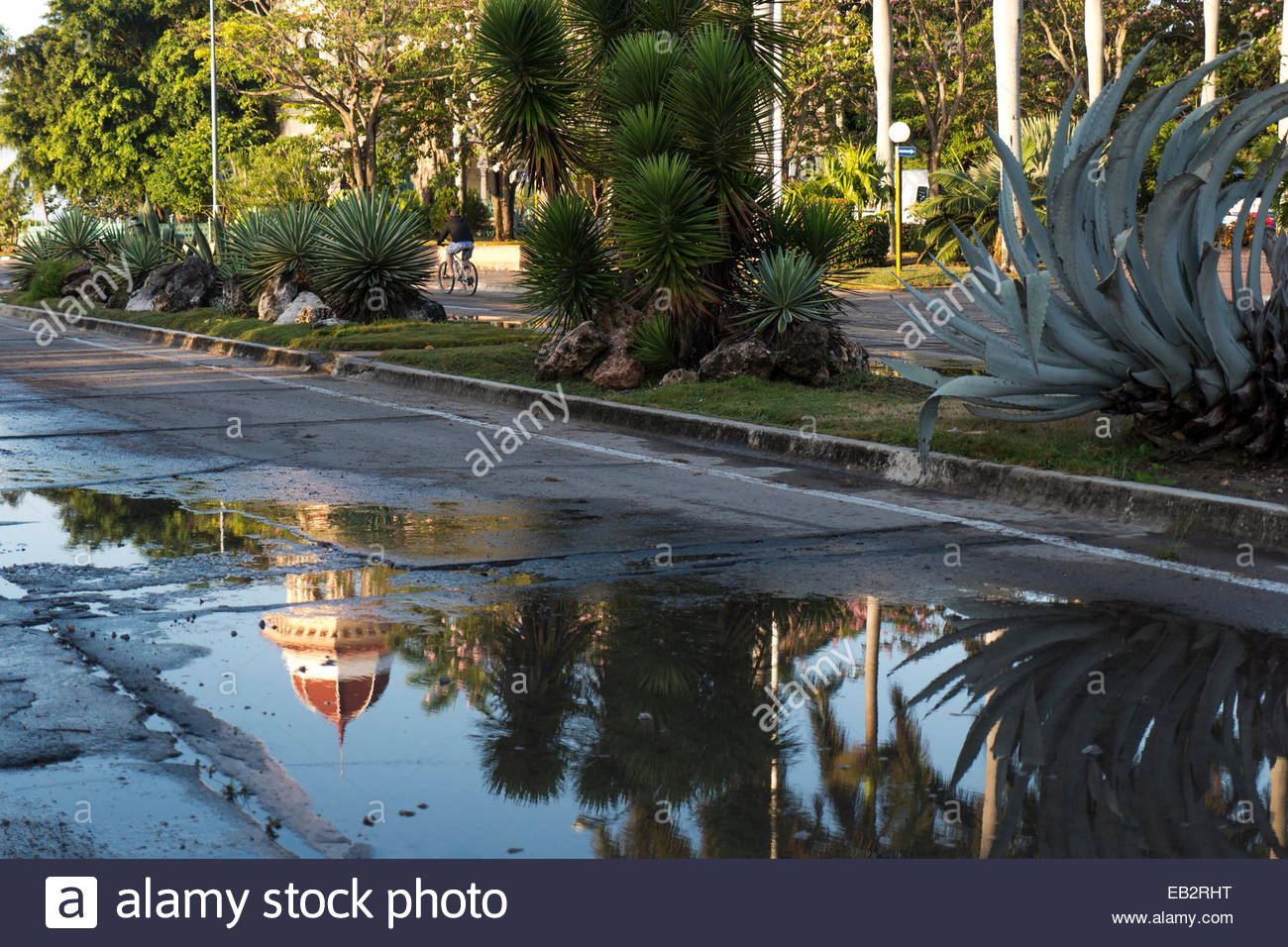 Early morning after a rainstorm, puddles in the street reflect the Palacio del Valle. - Stock Image