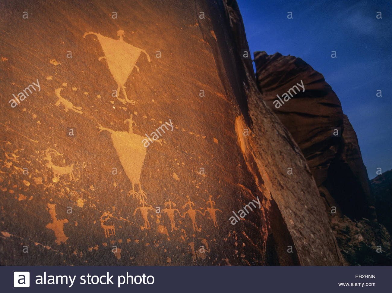 Anasazi rock art in Mill Creek Canyon just outside Moab at dusk. - Stock Image