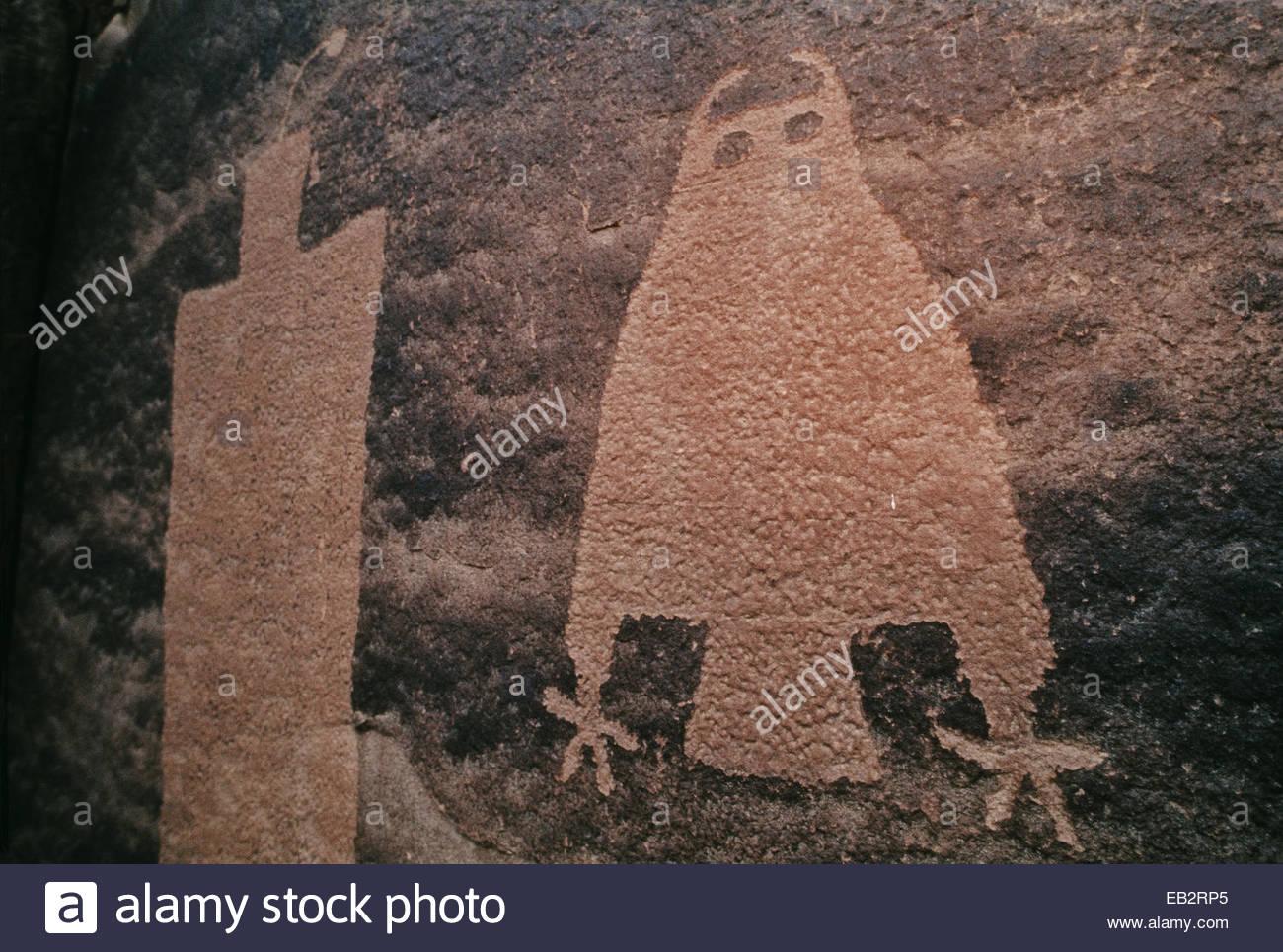Owl petroglyph in sandstone on Kane Creek just outside Moab, Utah. - Stock Image