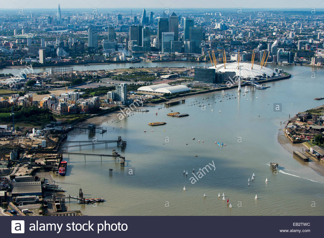 An aerial view of sailing dinghies competing in a race on the Thames river near Docklands with views of the O2 and - Stock Image