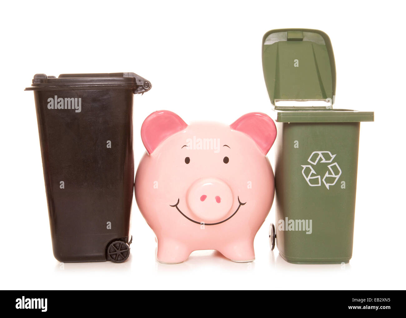 piggybank with trash cans cutout - Stock Image