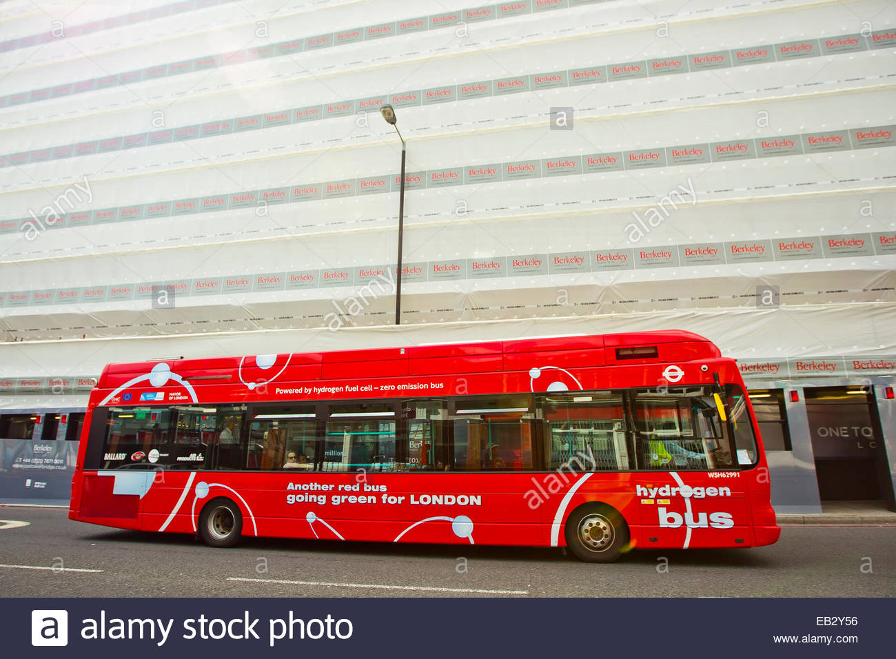 An efficient, non-polluting red hydrogen-powered bus on the streets of London. - Stock Image