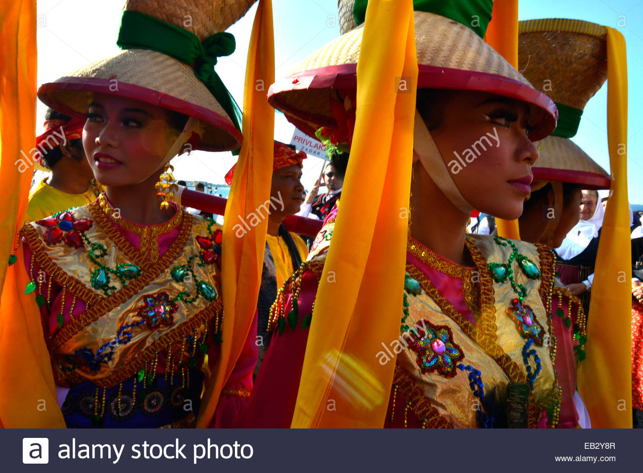 A delegation wearing traditional costumes at the World Championship of Folklore. - Stock Image