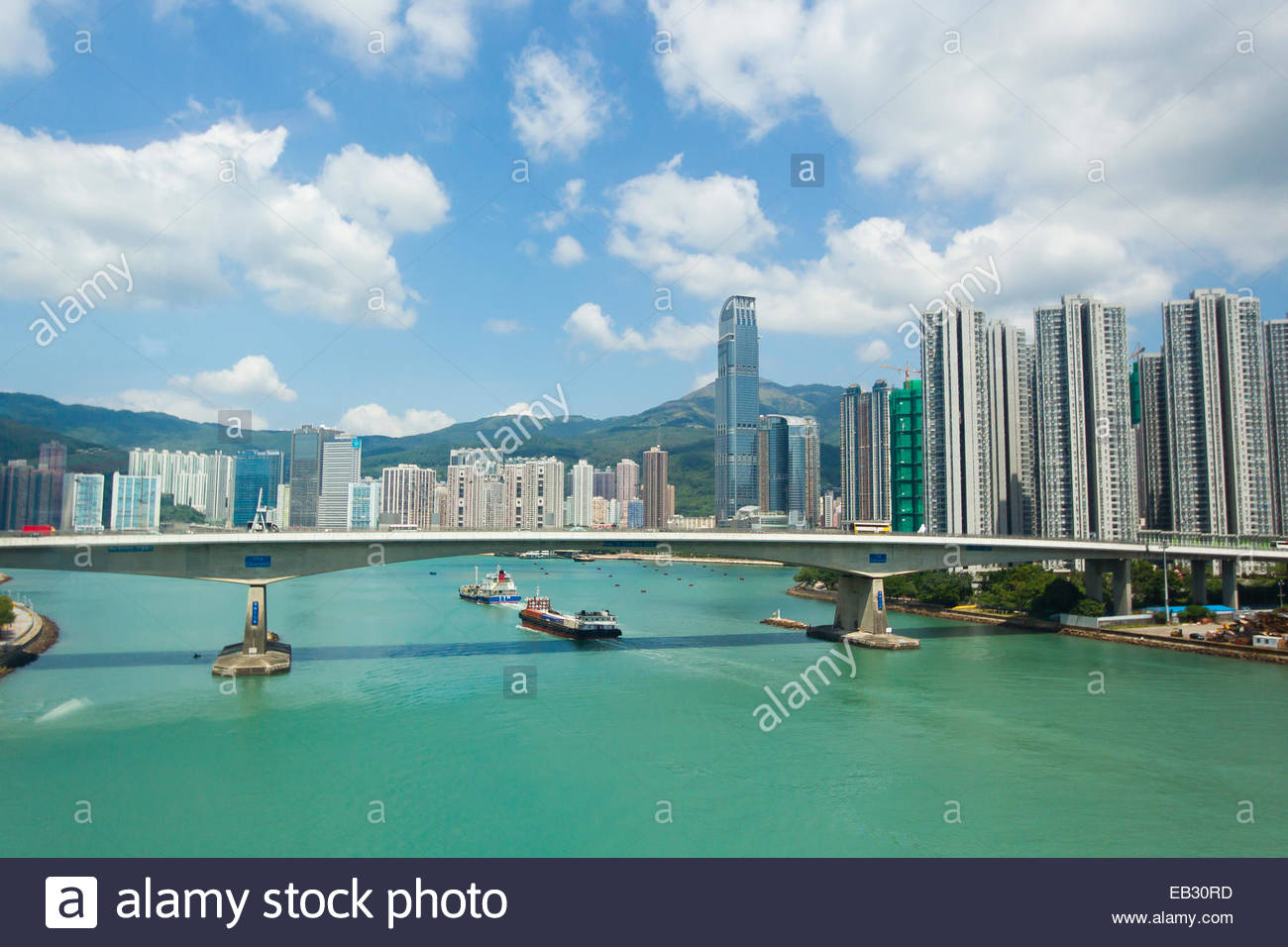A large modern bridge spanning the width of Victoria Harbor. - Stock Image