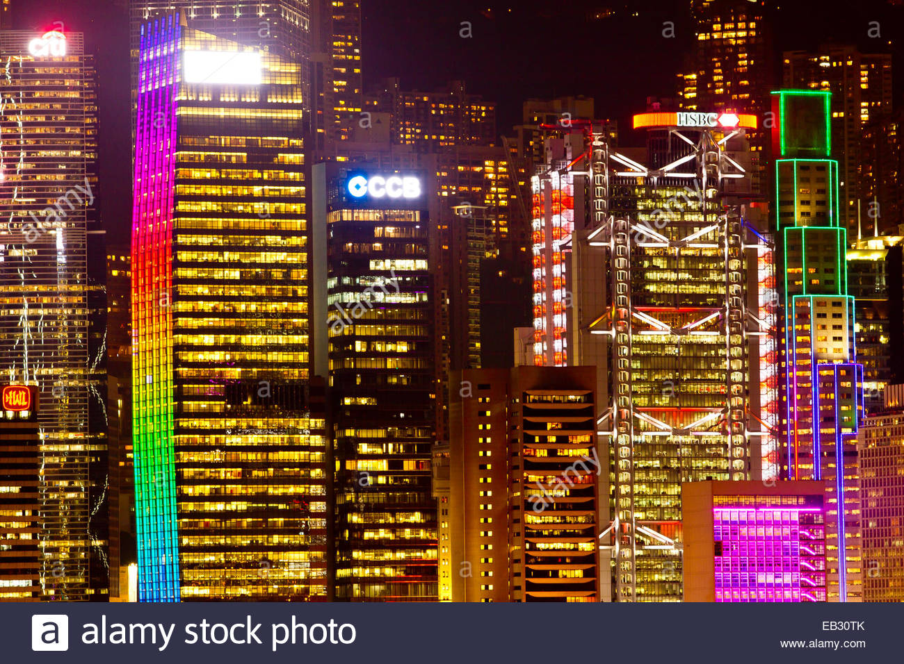 The colorful Hong Kong skyline completely lit up at night. - Stock Image
