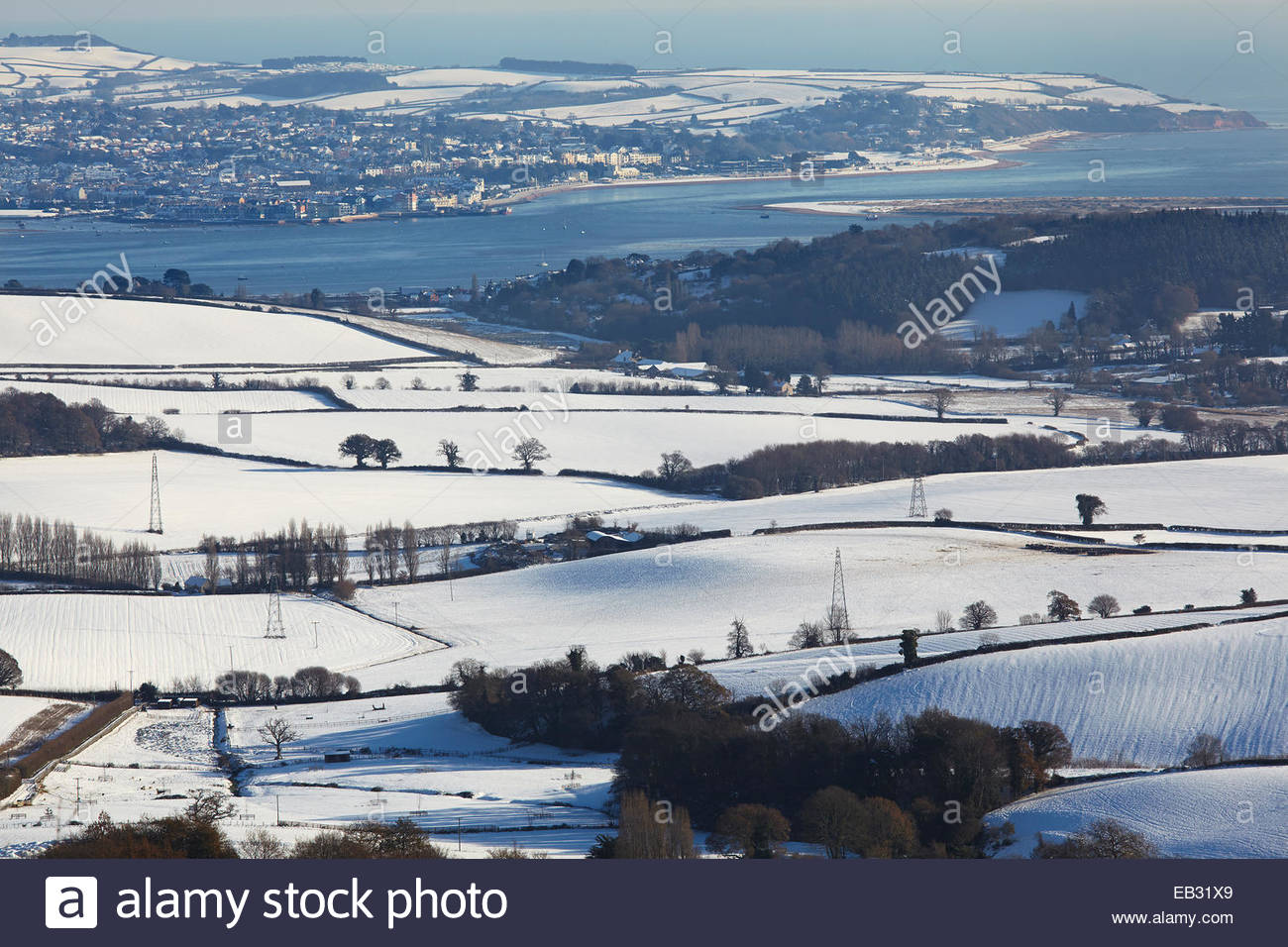 A snowy, wintry view across the estuary of the River Exe to Exmouth, from the Mamhead Viewpoint in the Haldon Hills, - Stock Image
