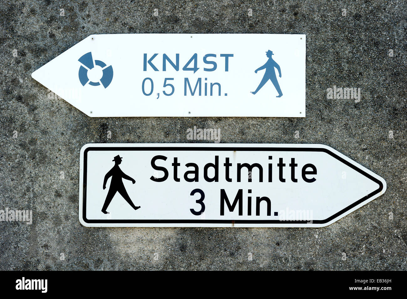 Signs, 'Knast' and 'Stadtmitte', German for 'Jail' and 'City centre', historic center, - Stock Image