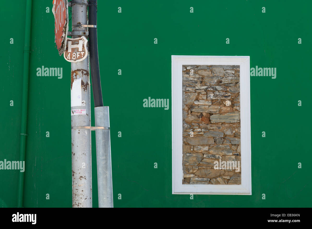 Stonewalled window in a green wall, Bo Kaap, Cape Town, South Africa - Stock Image