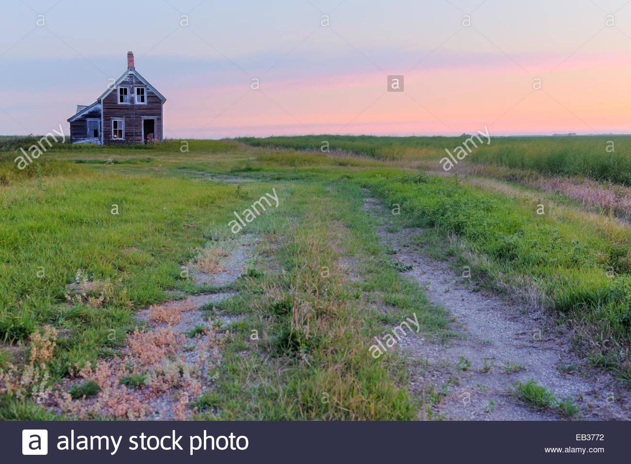 Sunrise. Abandoned farmstead on the USA-Canada border. - Stock Image