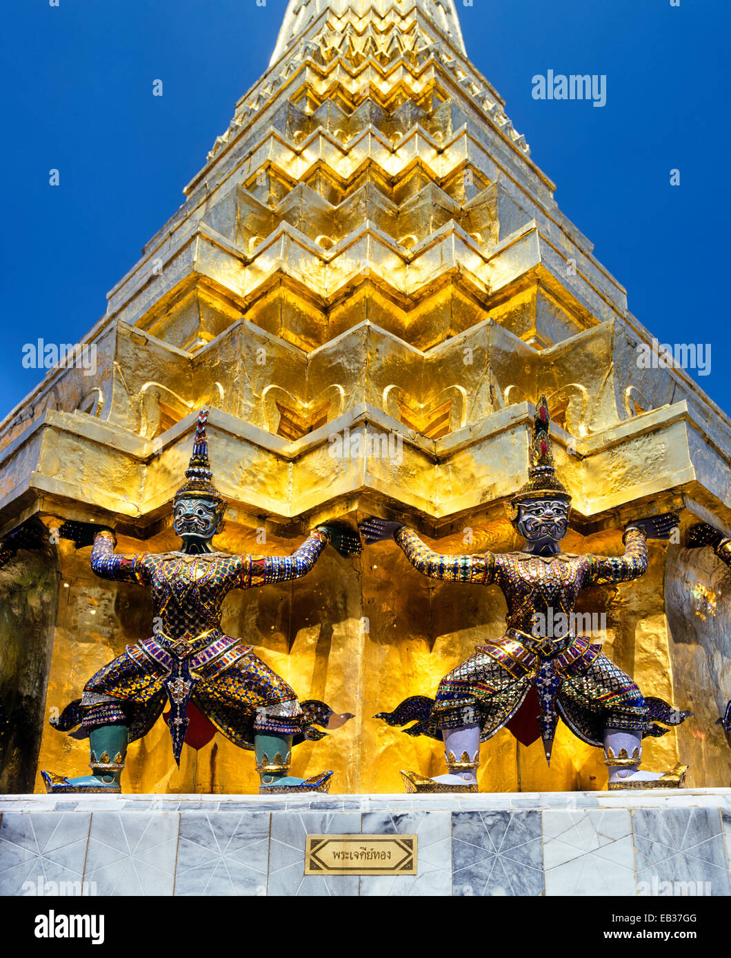 Wat Phra Kaeo Temple, Royal Palace, Caryatid demons on a golden chedi, Bangkok, Central Thailand, Thailand - Stock Image