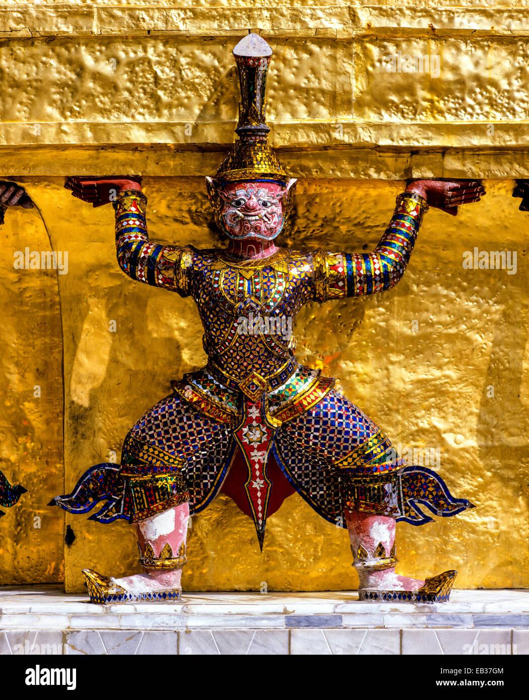 Wat Phra Kaeo Temple, Royal Palace, Caryatid demon on a golden chedi, Bangkok, Central Thailand, Thailand - Stock Image