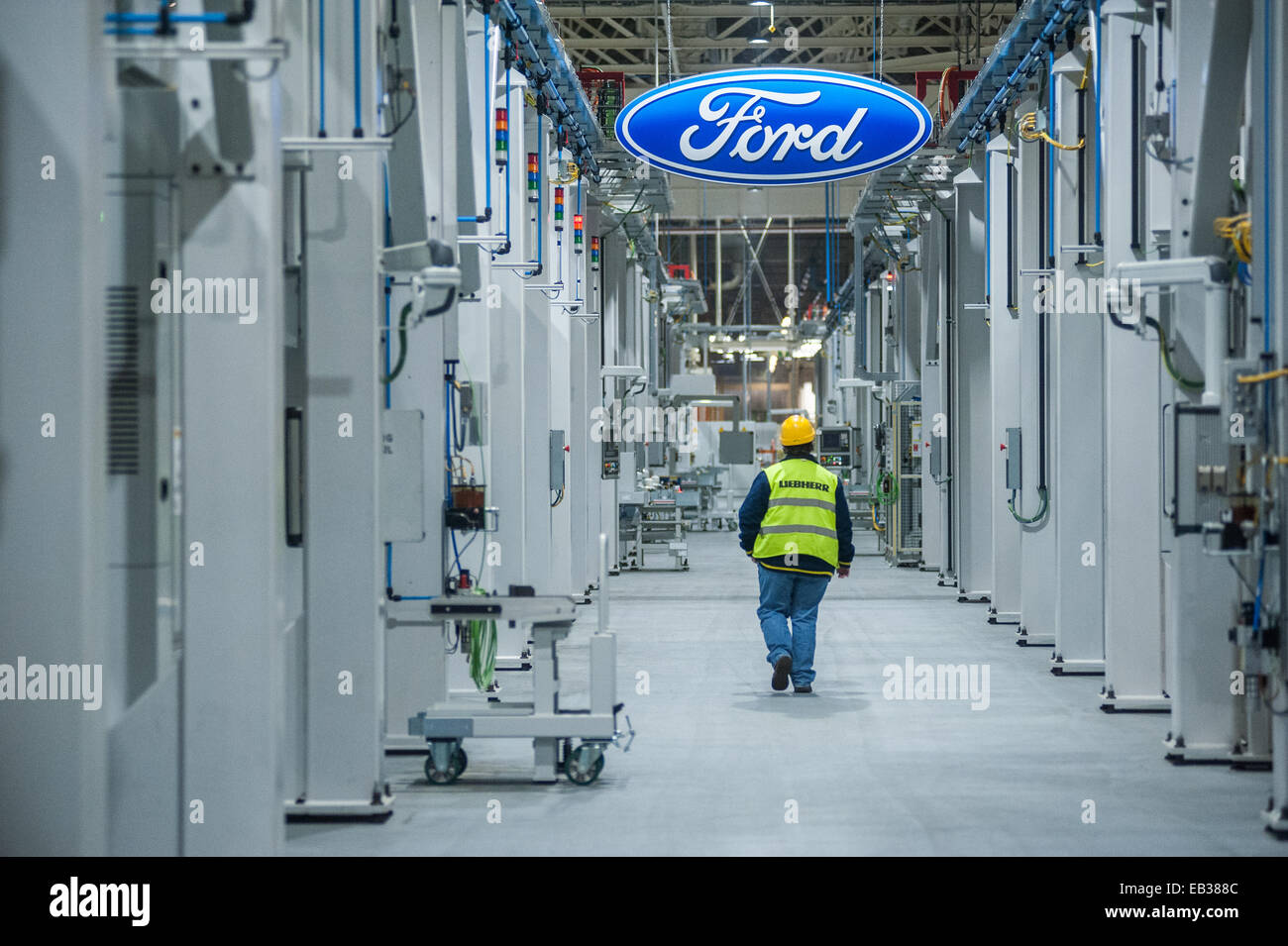 London, UK. 25th November, 2014. An employee of Ford Motor Co Ltd in Dagenham works at the assembly line as The - Stock Image