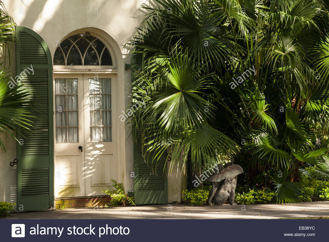 An arched door of the hexagonal guest house at the Houmas House Plantation and Gardens. - Stock Image