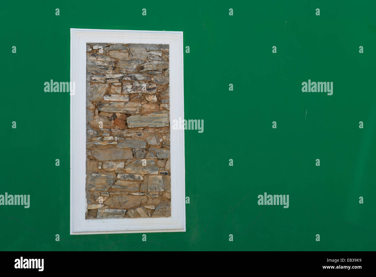 Stonewalled window in a green wall, Bo Kaap, Cape Town, South Africa Stock Photo