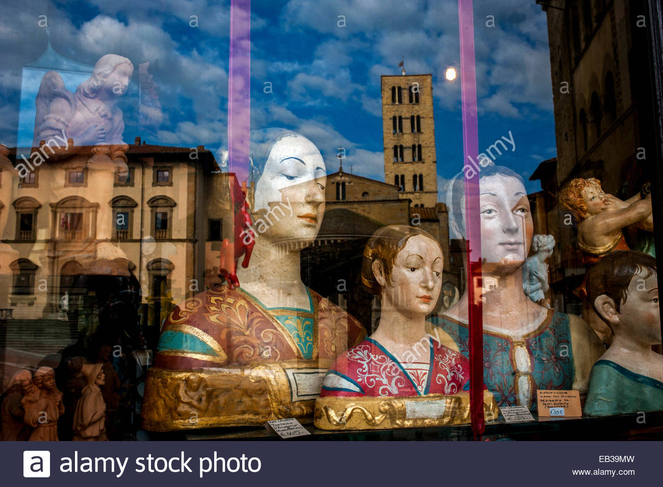 Busts of women in renaissance dress in the window of an