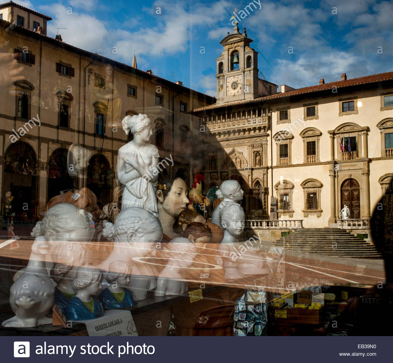 Busts of women and other sculpture in the window of an antique shop on the Piazza Grande. - Stock Image