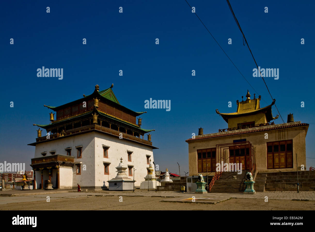 Mongolia, Ulan Bator, Gandan Khiid Monastery, Main Temple, View of two buildings against clear sky - Stock Image