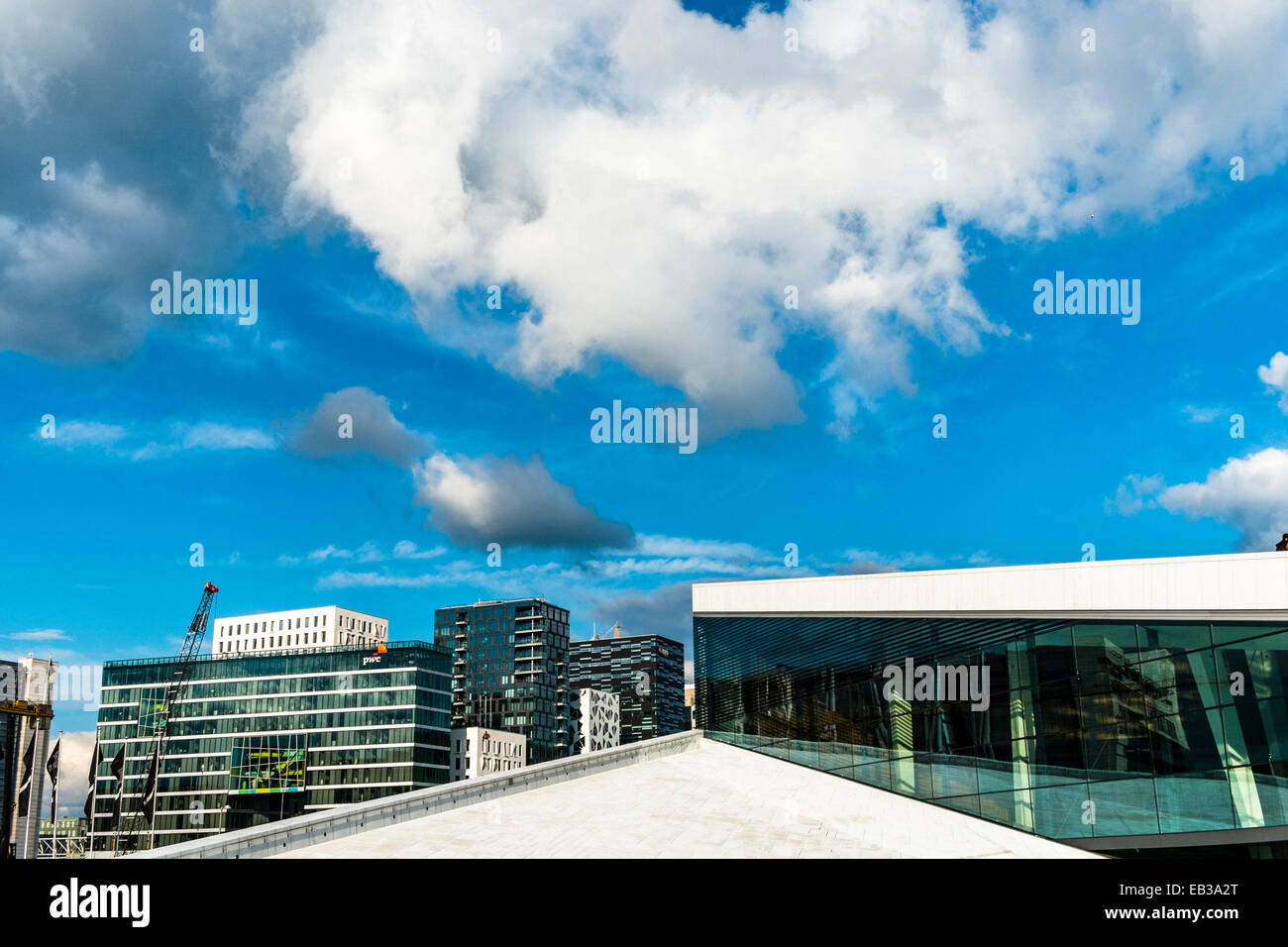Norway, Oslo, National Oslo Opera House, Partial view of roof with highrise buildings in background Stock Photo