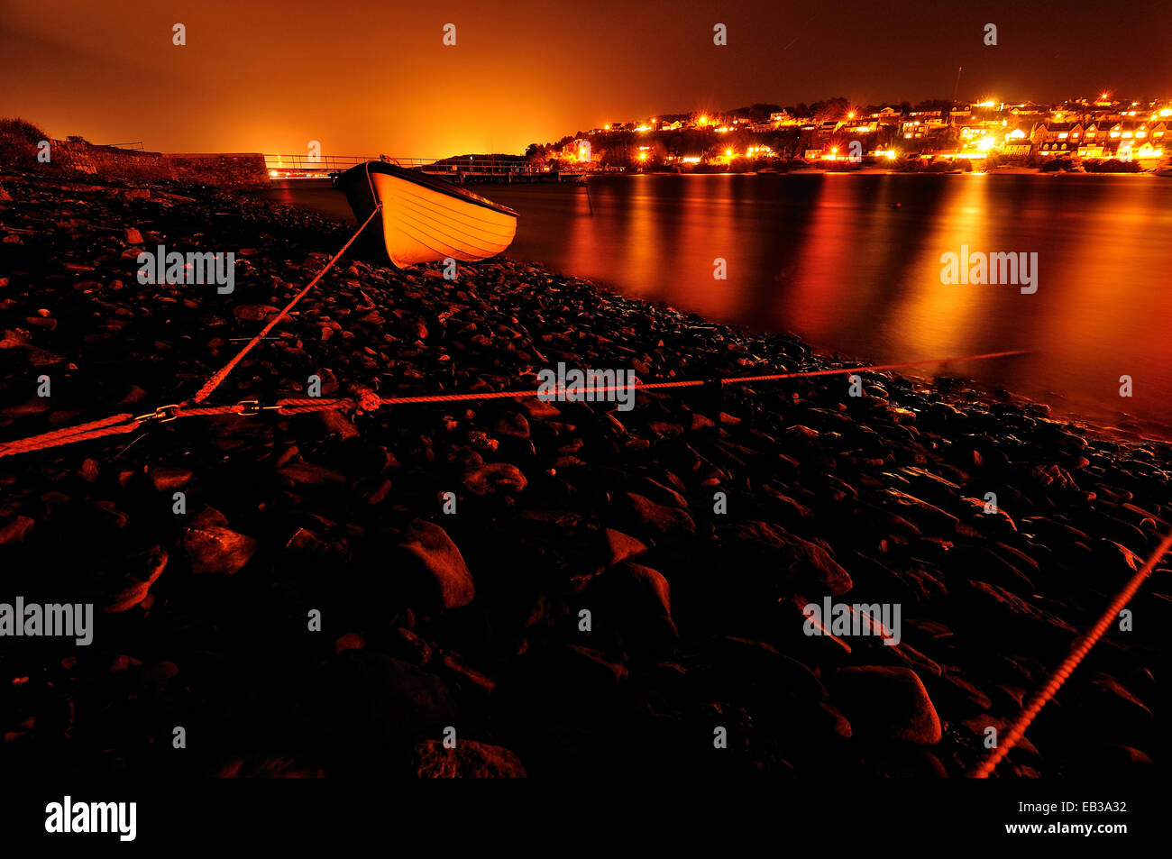 Ireland, Munster, County Cork, Crosshaven, Glowing townscape at night - Stock Image