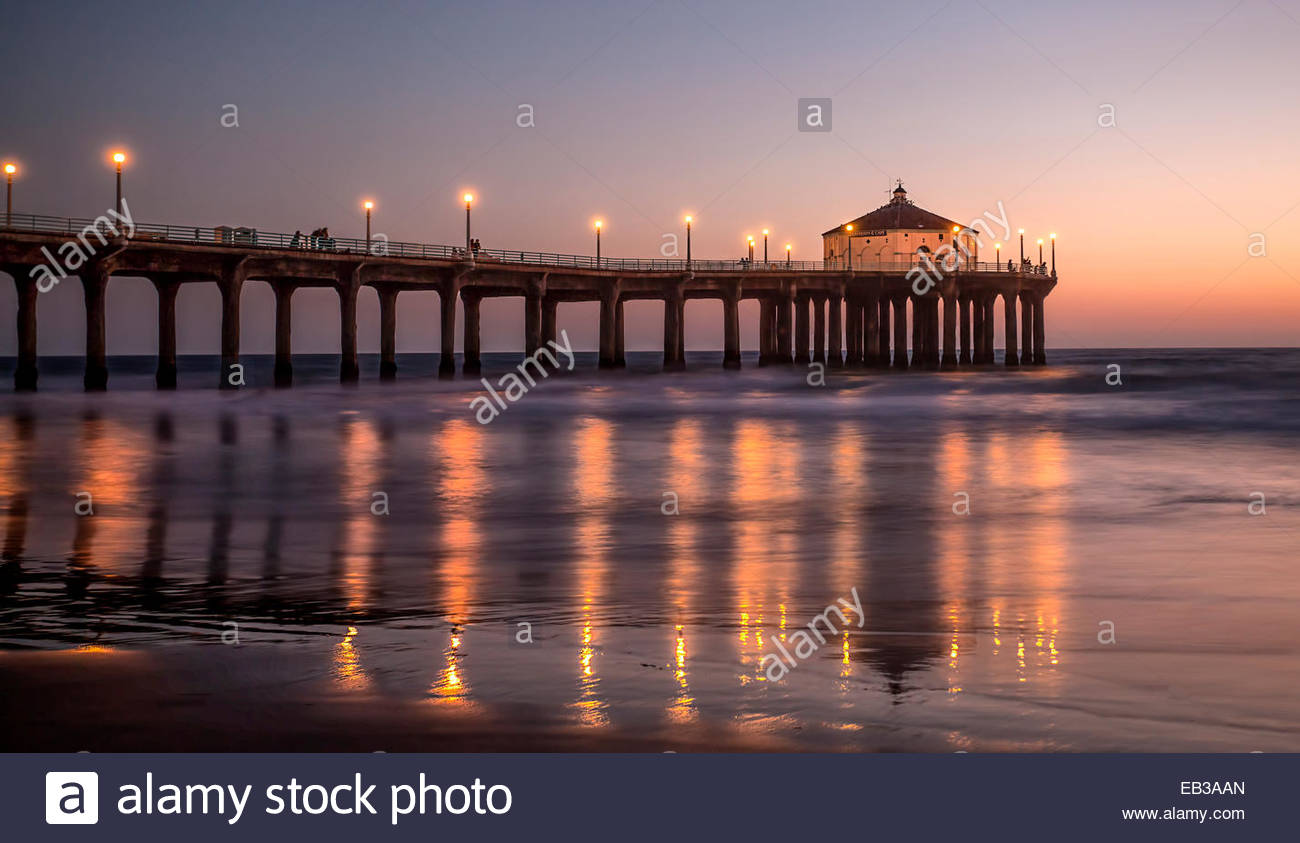Pier reflections at night, Manhattan Beach, California, America, USA - Stock Image