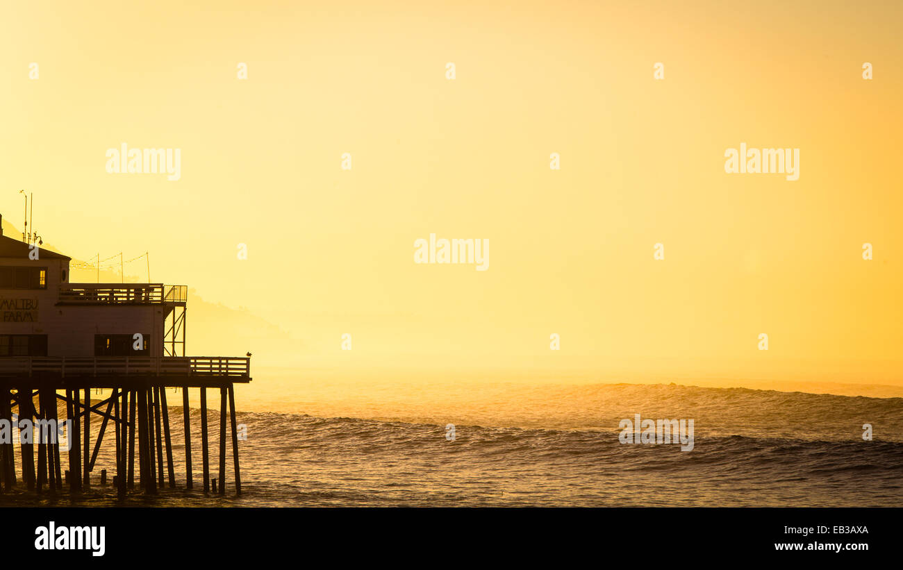 USA, California, Los Angeles County, Malibu, Silhouette of pier at sunset - Stock Image