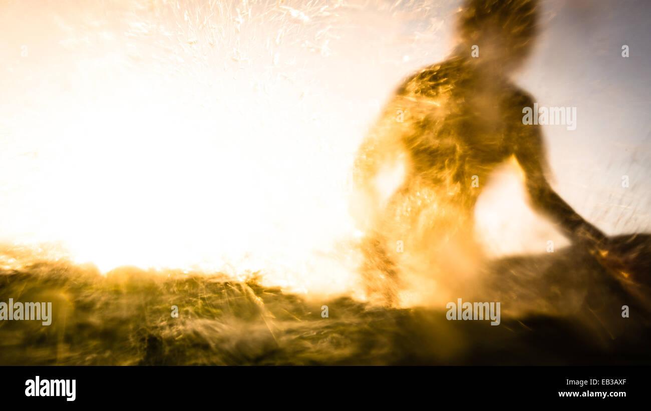 USA, California, Los Angeles County, Malibu, Silhouette of surfer - Stock Image