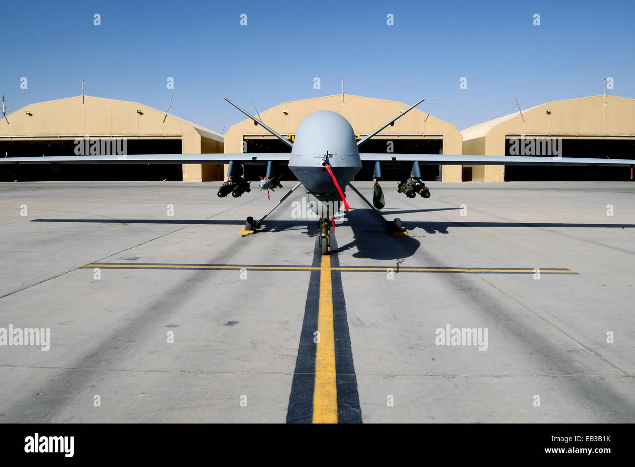 An U.S Air Force MQ-9 Reaper with the 62nd Expeditionary Reconnaissance Squadron sits on a ramp at Kandahar Airfield - Stock Image