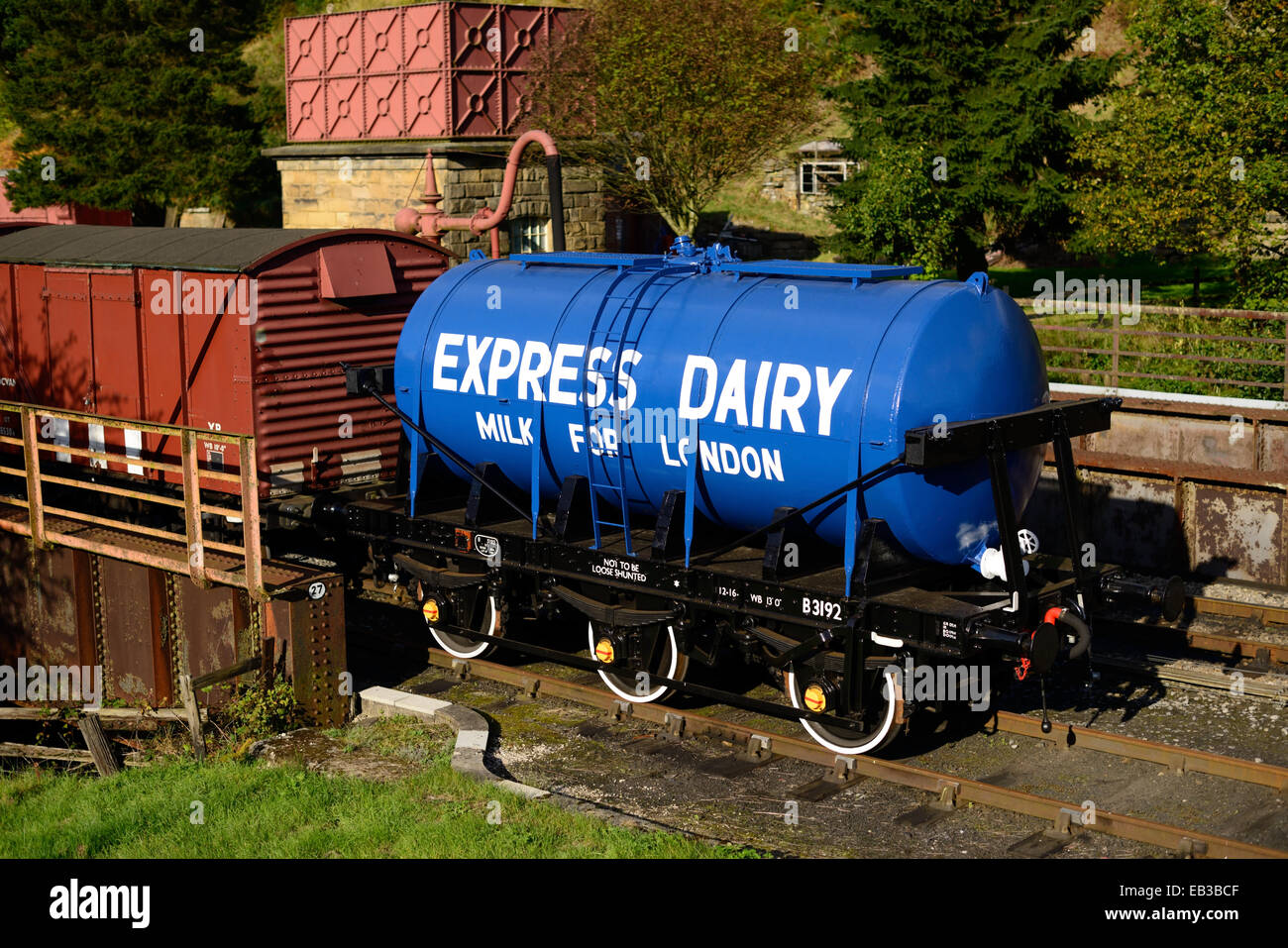 Recently restored milk tank standing in a siding at Goathland station on the North Yorkshire Moors Railway. - Stock Image