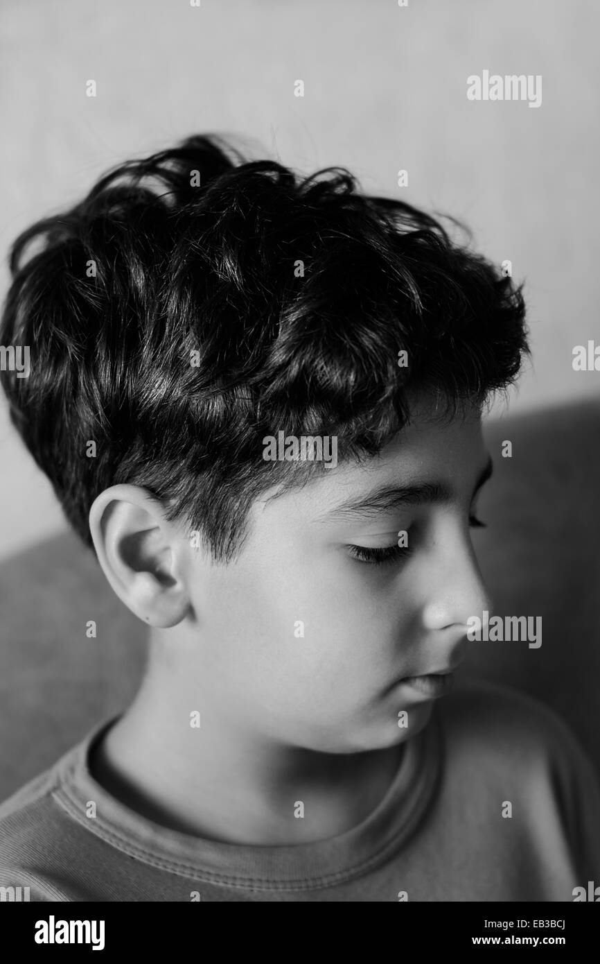Boy (10-11) portrait in black and white - Stock Image