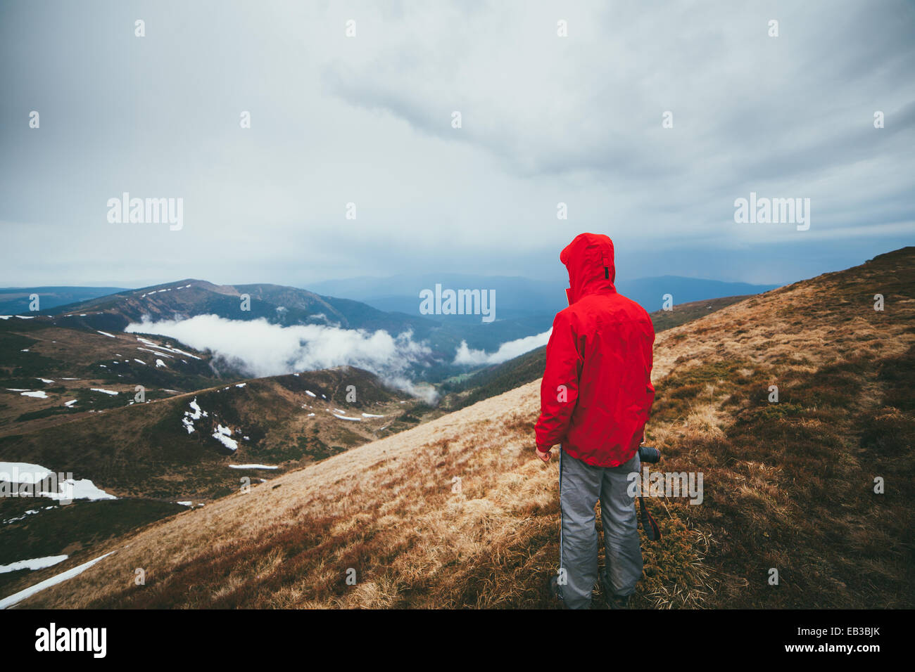 Hiker in mountains Stock Photo