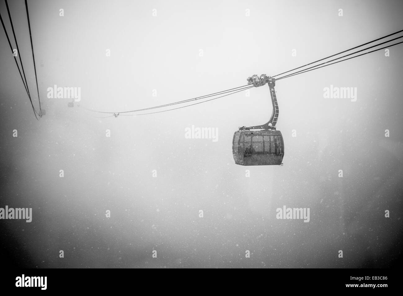 Canada, British Columbia, Gondola in heavy snow fall in Whistler - Stock Image